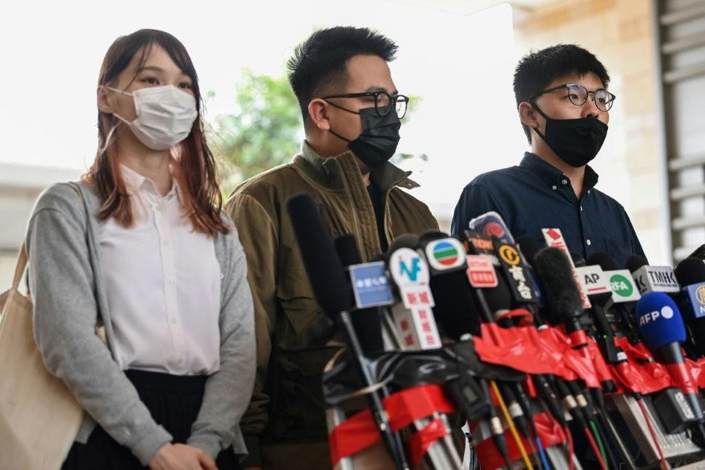 Activists (L-R) Agnes Chow, Ivan Lam and Joshua Wong joined Hong Kong's pro-democracy movement when they were in their teens
