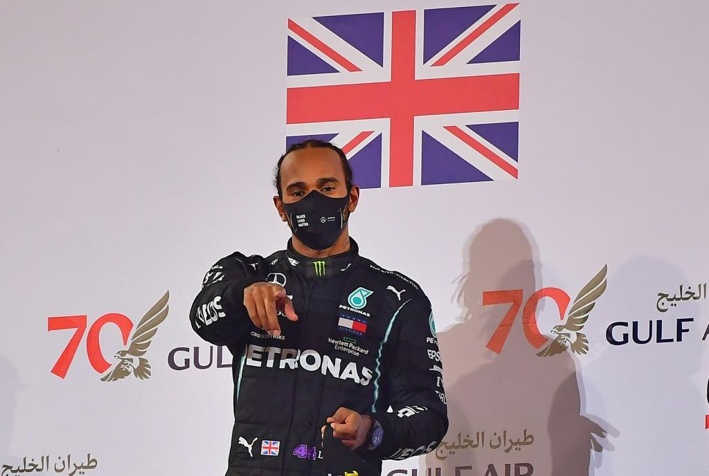Formula One world champion Lewis Hamilton -- seen here celebrating his victory in Bahrain -- has tested positive for the virus