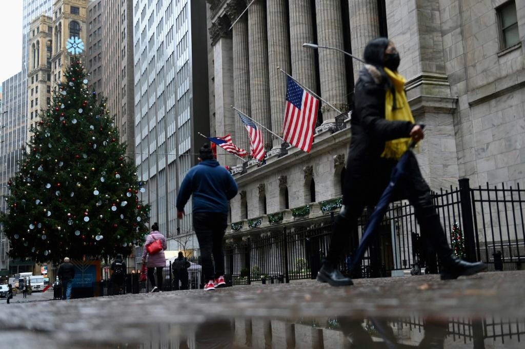 People walk past the New York Stock exchange (NYSE) on Wall Streetin New York City in November 2020: a new bill could close US money and stock markets to Chinese firms soon