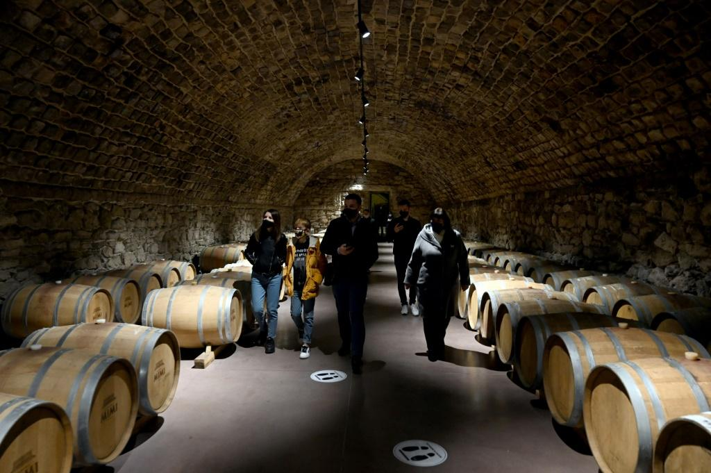 A group of tourists enjoy wandering the endless labyrinthine cellars at Cricova, which produces some 11 million bottles annually