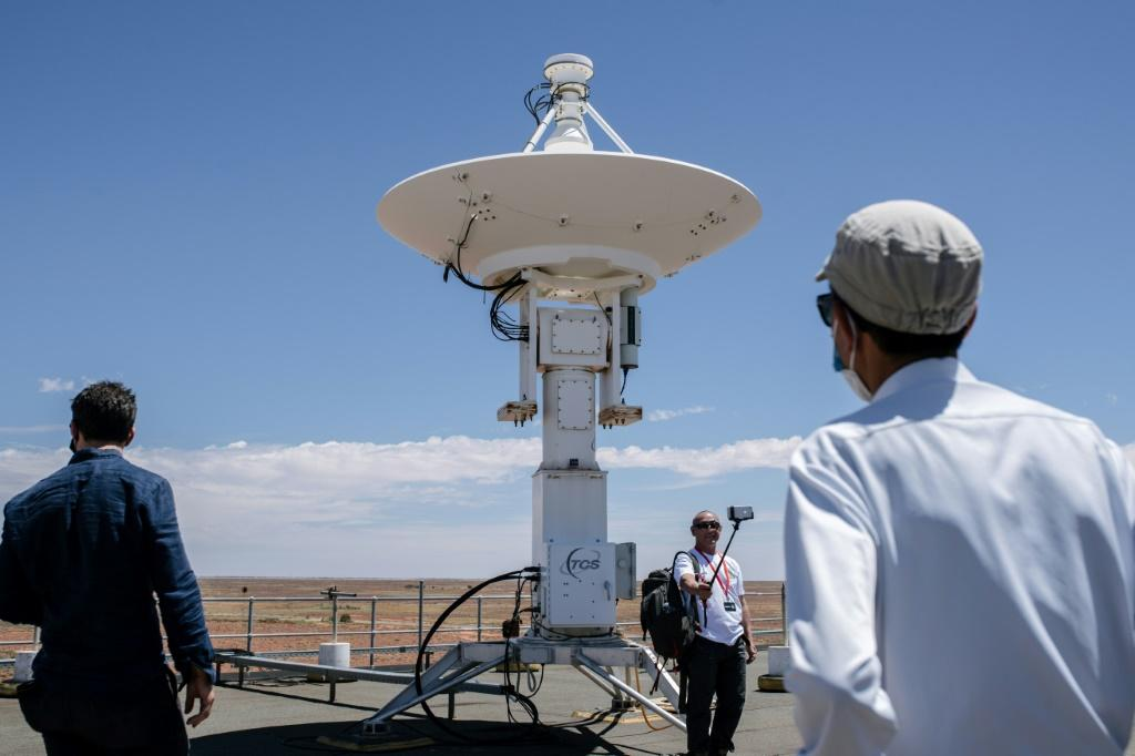 Japan Aerospace Exploration Agency (JAXA) officials and reporters tour the roof of the Royal Australian Air Force's Woomera Range Complex in South Australia ahead of capsule's arrival