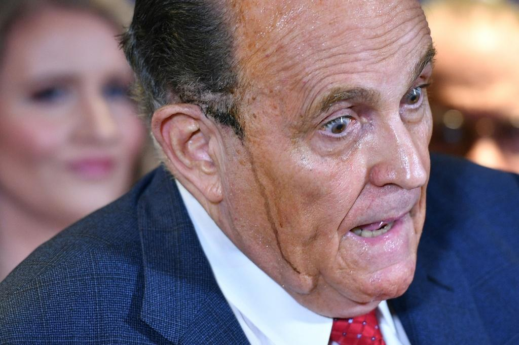 Donald Trump's personal lawyer Rudy Giuliani (pictured November 19, 2020) is often seen without a mask when he appears in public to defend the president's already fading efforts to challenge his election loss