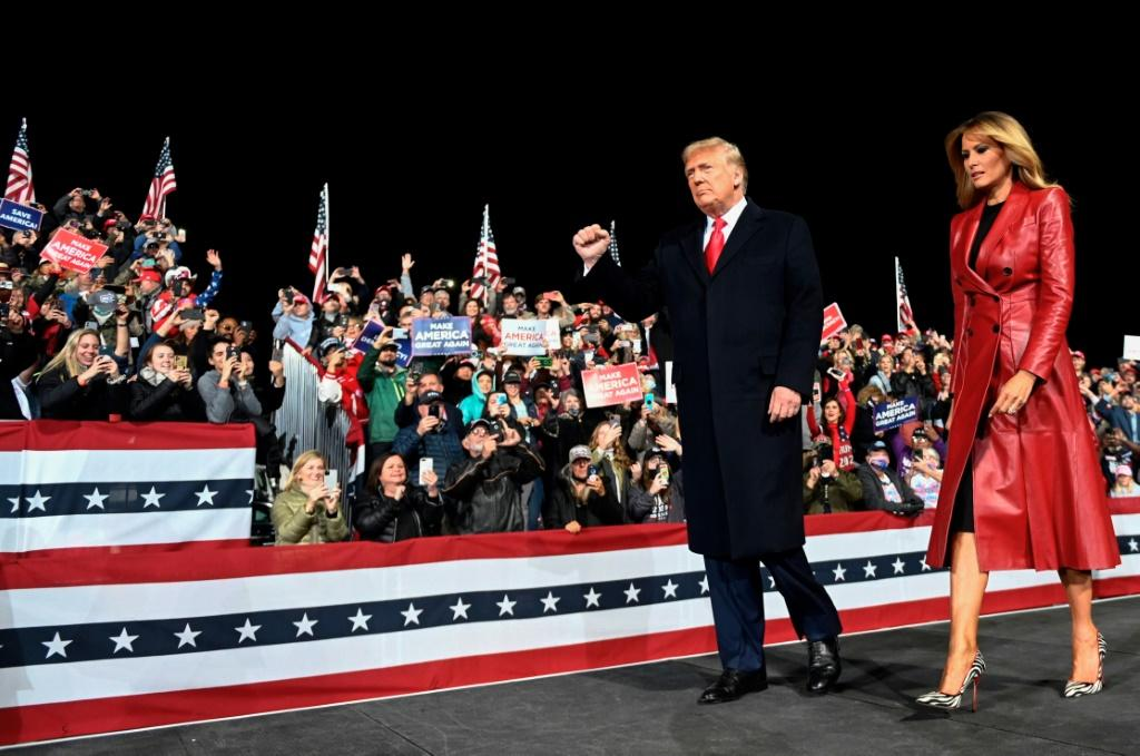 US President Donald Trump and his wife Melania Trump (pictured December 5, 2020 at a rally in Valdosta, Georgia) both contracted the coronavirus weeks before the November 3, 2020 presidential election