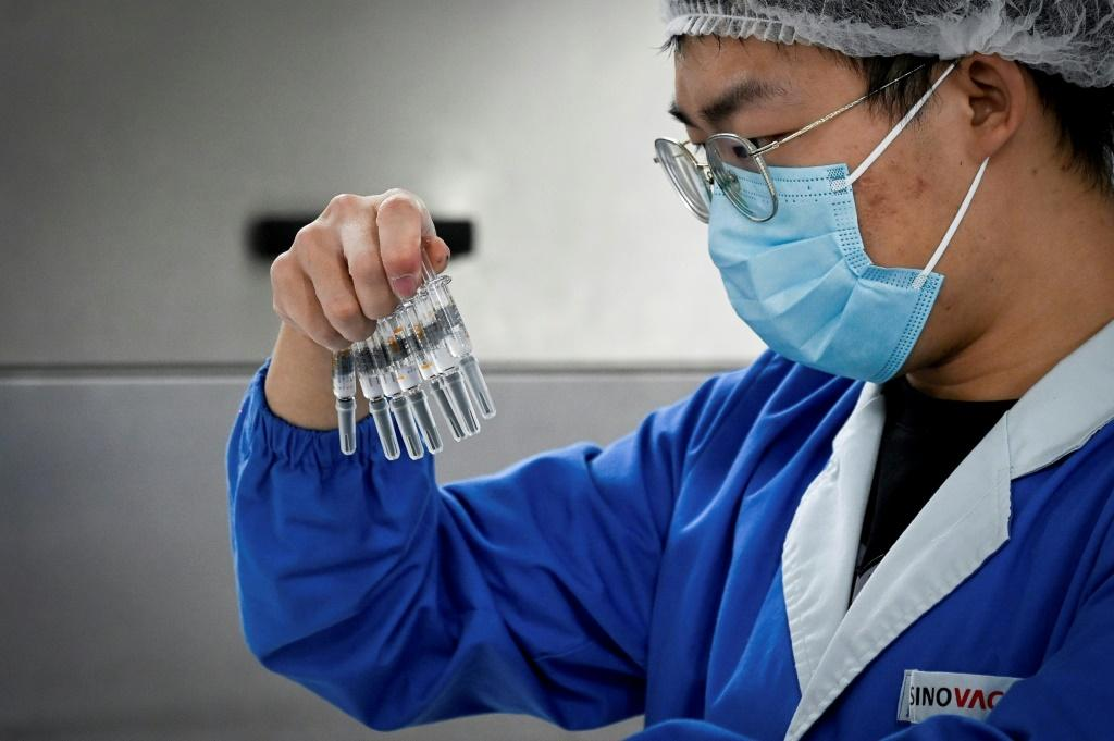 Beijing has pledged to give poorer nations priority access to its vaccines, in a move analysts say is designed to increase China's global influence