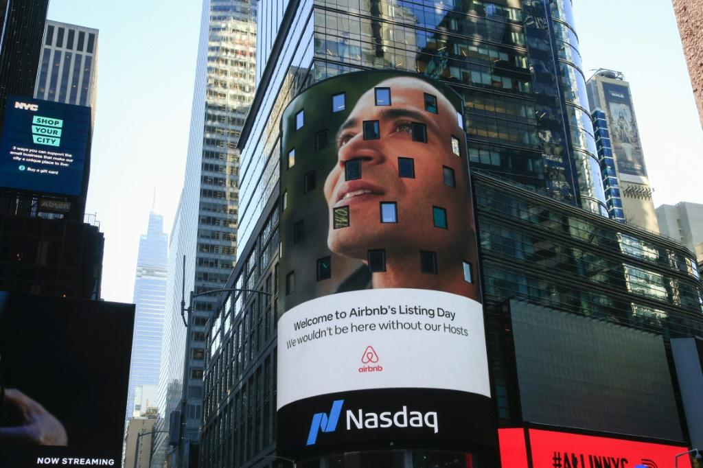 The Airbnb logo is displayed on the Nasdaq digital billboard in Times Square in New York as the home sharing platform made its US stock market debut
