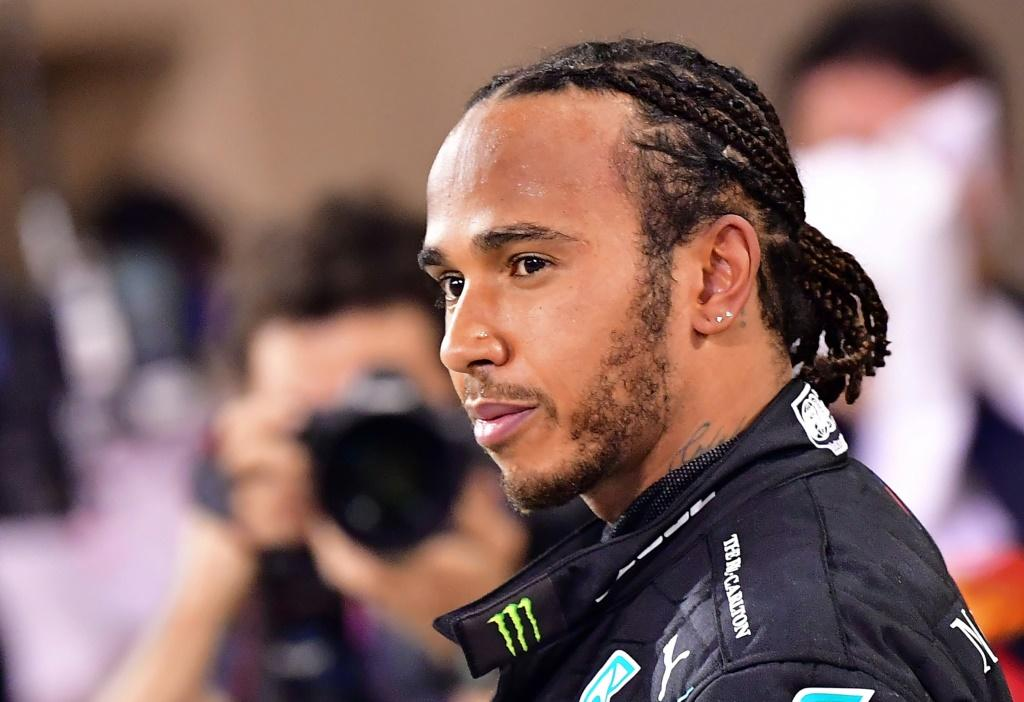 Back in business: Lewis Hamilton will race in the season-ending Abu Dhabi Grand Prix
