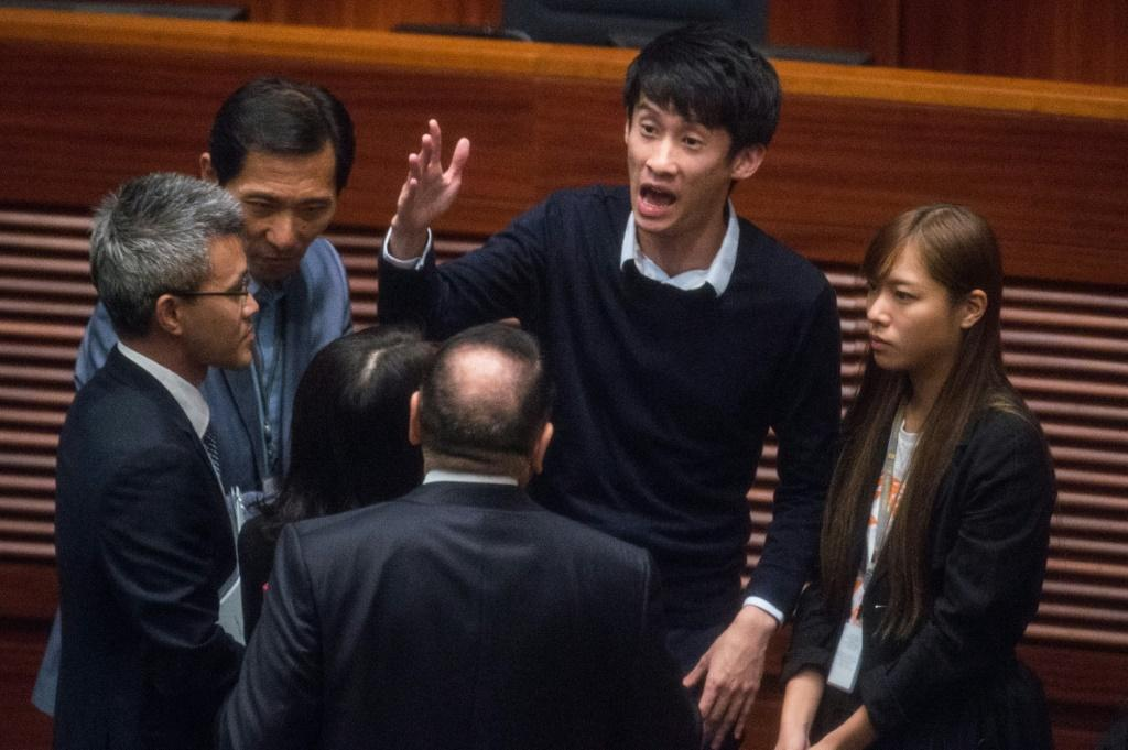 Former Hong Kong lawmaker Sixtus Leung (pictured with hand raised during a protest at the Legislative Council in 2016) says he is seeking asylum in the United States