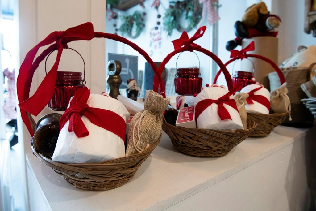 Gift baskets containing toilet paper are displayed inside a restaurant trying to adapt and attract more customers during the coronavirus pandemic and stay-at-home orders in Los Angeles, California