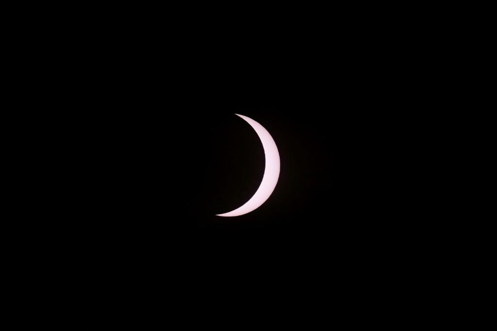 A sliver of the sun is seen just before the total solar eclipse as seen from Piedra del Aquila, Argentina on December 14, 2020