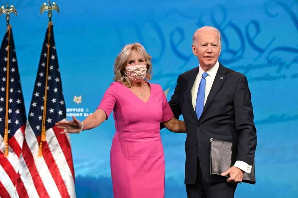 US President-elect Joe Biden, seen with his wife Dr Jill Biden, advanced closer towards his January 20, 2021 inauguration with the Electoral College formally affirming his election victory over President Donald Trump