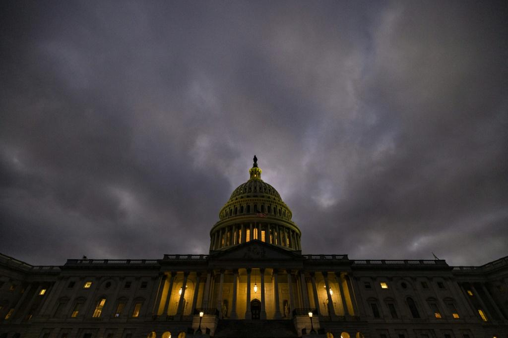 Dusk falls over the US Capitol building on December 20, 2020 -- as Republicans and Democrats finally came to an agreement on a massive coronavirus relief bill