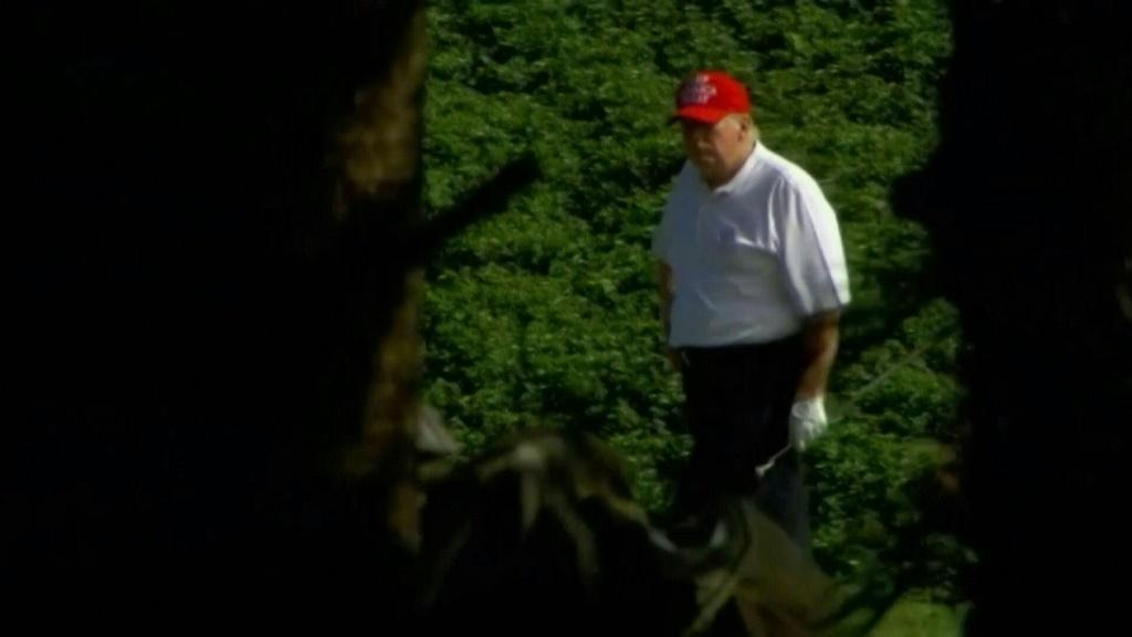 IMAGESUS President Donald Trump plays golf at his club in West Palm Beach, Florida. Trump's golf outing comes a day after he signed a massive $900 billion stimulus bill that extends benefits to millions of Americans struggling through the pandemic. [COMP