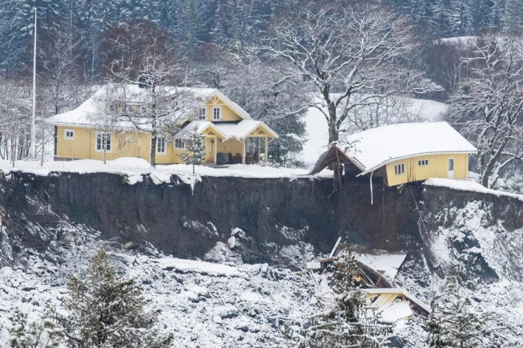 A landslide north of the Norwegian capital Oslo last Wednesday swallowed up or badly damaged homes like this one. Rescue workers say they still hope to find survivors in air pockets.