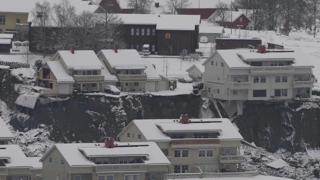 Rescue workers have recovered a second body and continued searching for another eight people still missing days after a landslide buried homes in a Norwegian village.