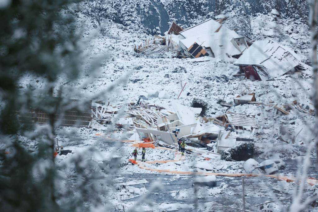 Rescue workers search for survivors