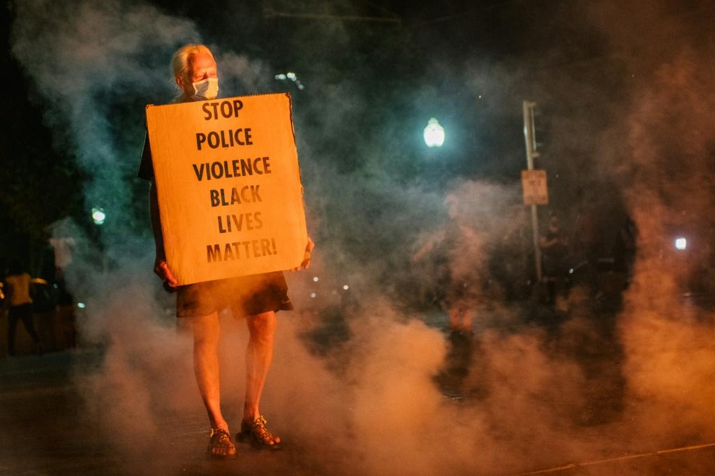 A protestor in Kenosha, Wisconsin last August after the police shooting of African American Jacob Blake.