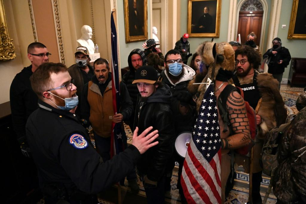 Supporters of US President Donald Trump confront Capitol police officers at the US Capitol on January 6, 2021, in Washington aiming to derail the certification of the November election results