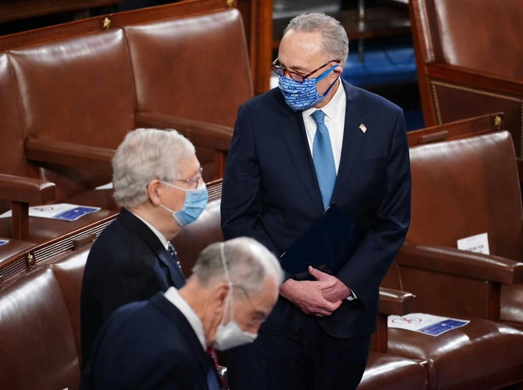 Top Senate Democrat Chuck Schumer stands with Senate Republican leader Mitch McConnell in a session to certify Joe Biden's election victory