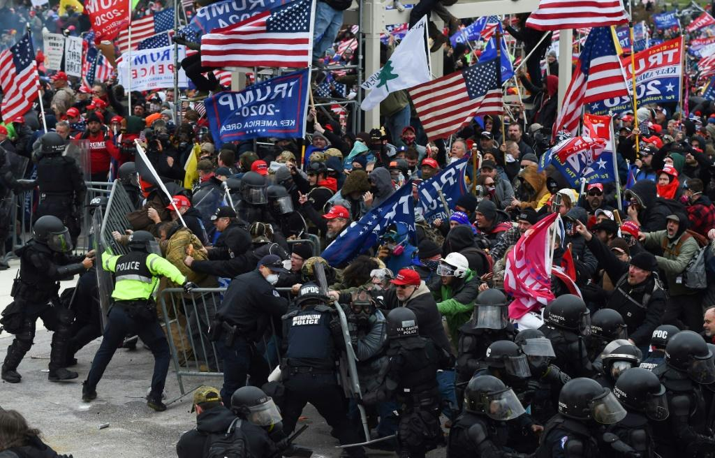 Trump supporters clash with police and security forces as they push barricades to storm the US Capitol in Washington D.C