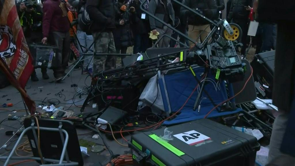 Trump supporters smash media equipment outside the US Capitol