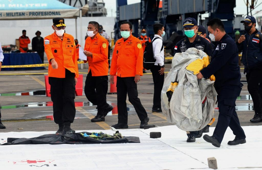 Body parts and debris have been found from Sriwijaya Air flight SJ182 that crashed near Jakarta