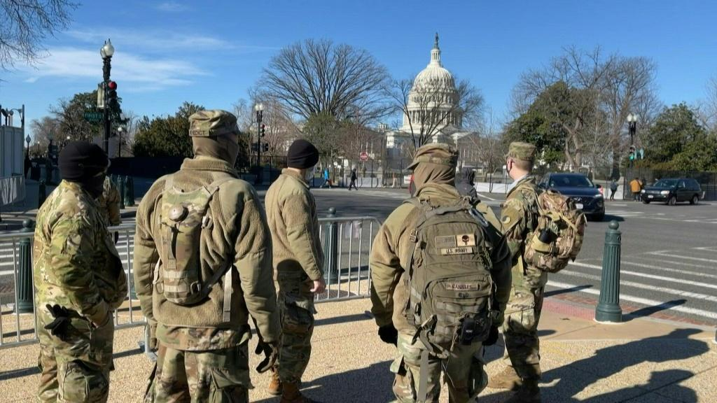 National Guard soldiers stand guard outside buildings around the US Capitol