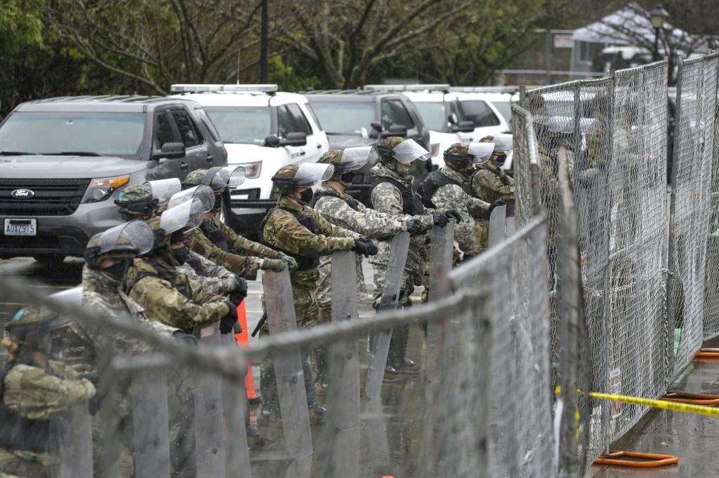The National Guard in the Washington State protect the legislature in the state capital of Olympia, ahead of its initial session for the year
