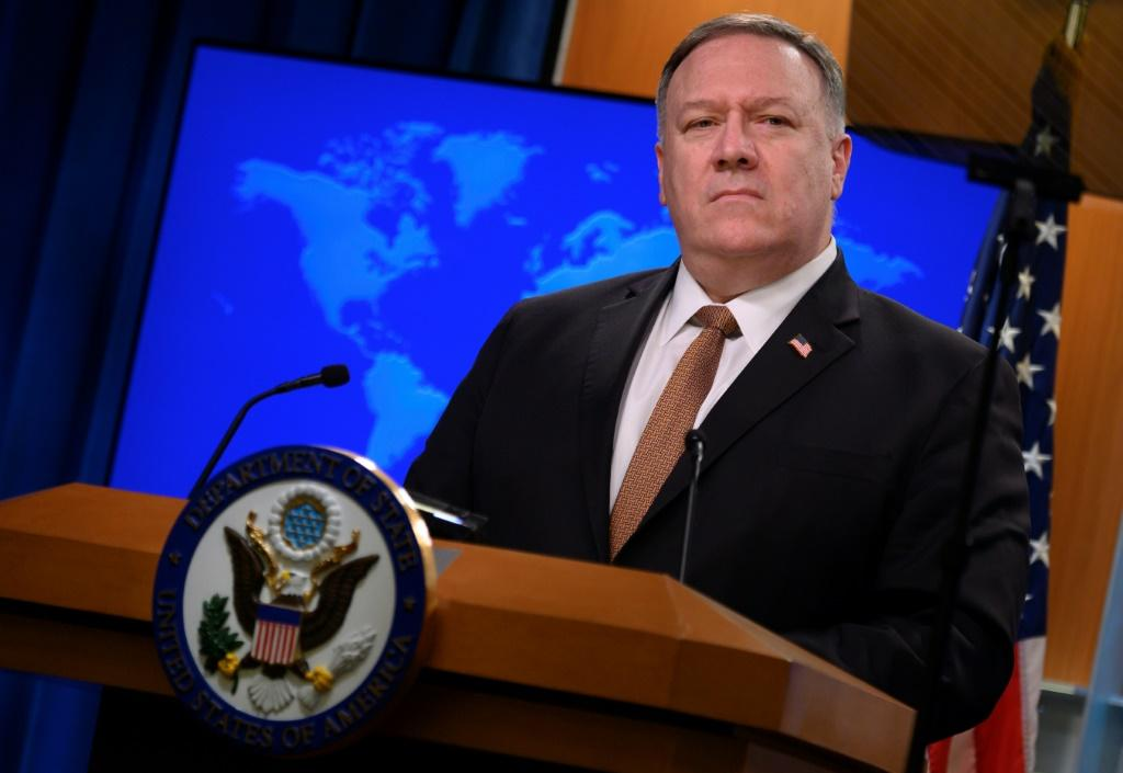 A Voice of America journalist was reassigned after seeking to pose a question during a visit to the broadcaster by Secretary of State Mike Pompeo, seen here in March 2020