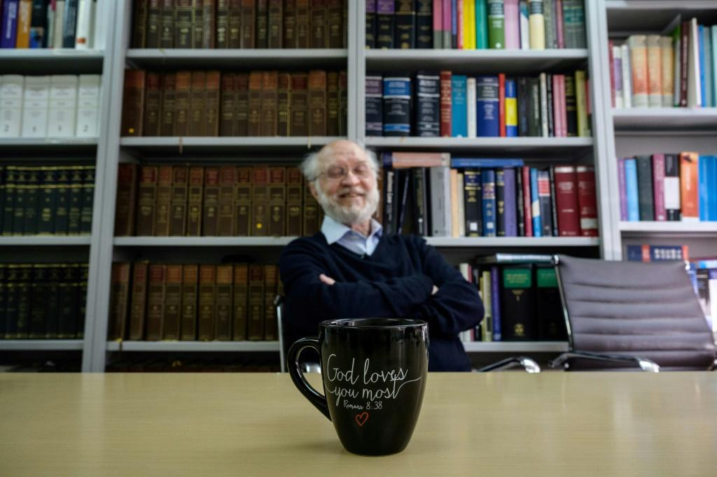 Clancey first came to Hong Kong in 1968 as a Catholic missionary priest; his office mug has a verse from the Bible written on it