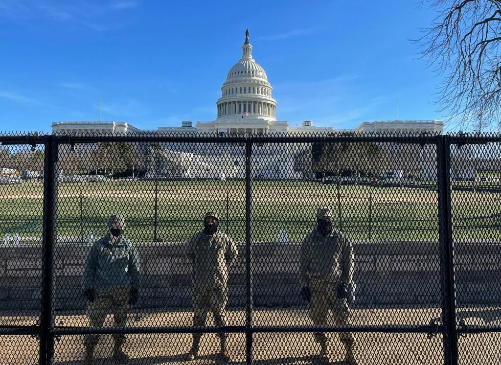 US National Guard soldiers guard the US Capitol grounds