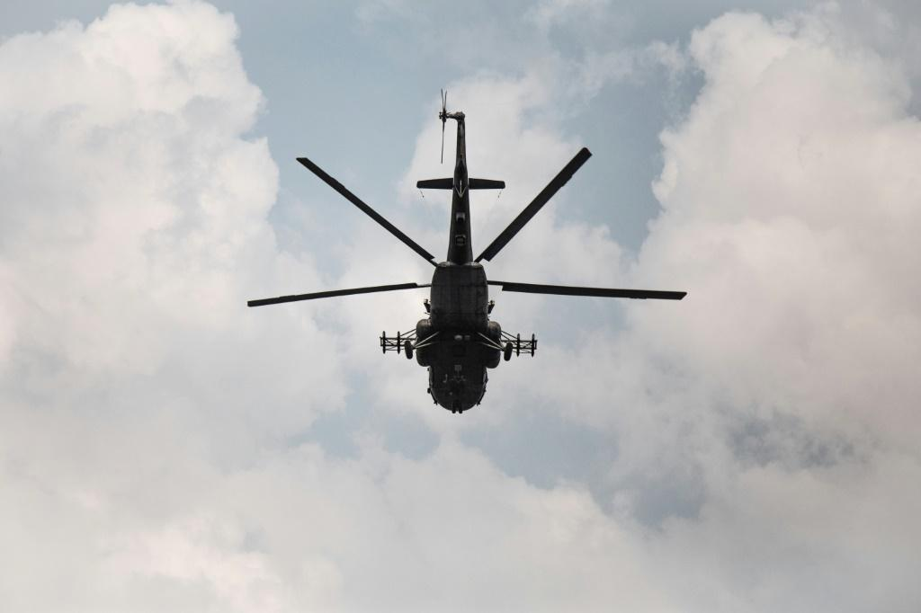 A Russian-made MI-17 helicopter supporting Russian paramilitaries, Rwandan forces and government troops flies over Boali, the gateway to Bangui, on Sunday