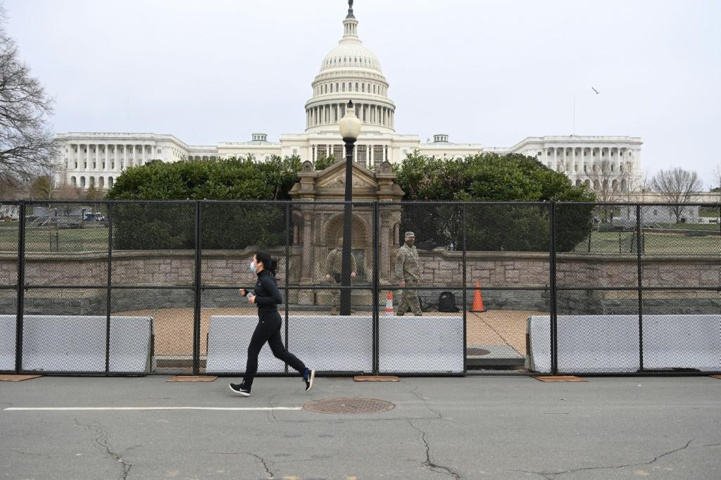 A security fence was erected around the US Capitiol ground after the violent storming by Trump supporters
