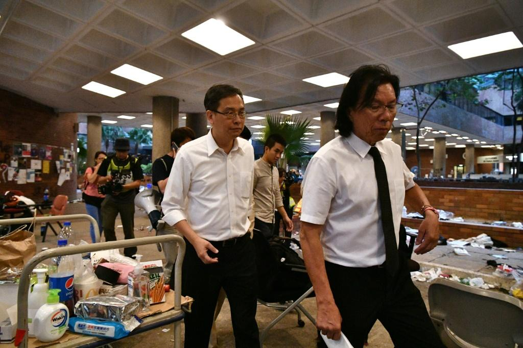 Daniel Wong (right) was among those arrested in the sweep