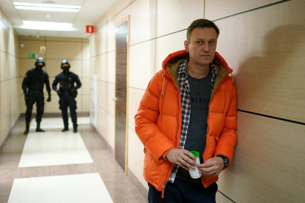 Navalny stands near law enforcement agents in a hallway of the business centre that houses the office of his Anti-Corruption Foundation (FBK) in Moscow in December 2019
