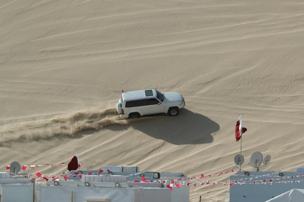 A 4x4 vehicle drives on a dune of Qatar's Sealine desert, around 63 kilometres south of the capital Doha, where off-roading is a hugely popular pastime