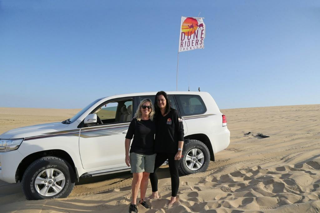 """South African Marcelle Visser (L) says she fell in love with the desert """"as soon as my tyres touched the sand"""