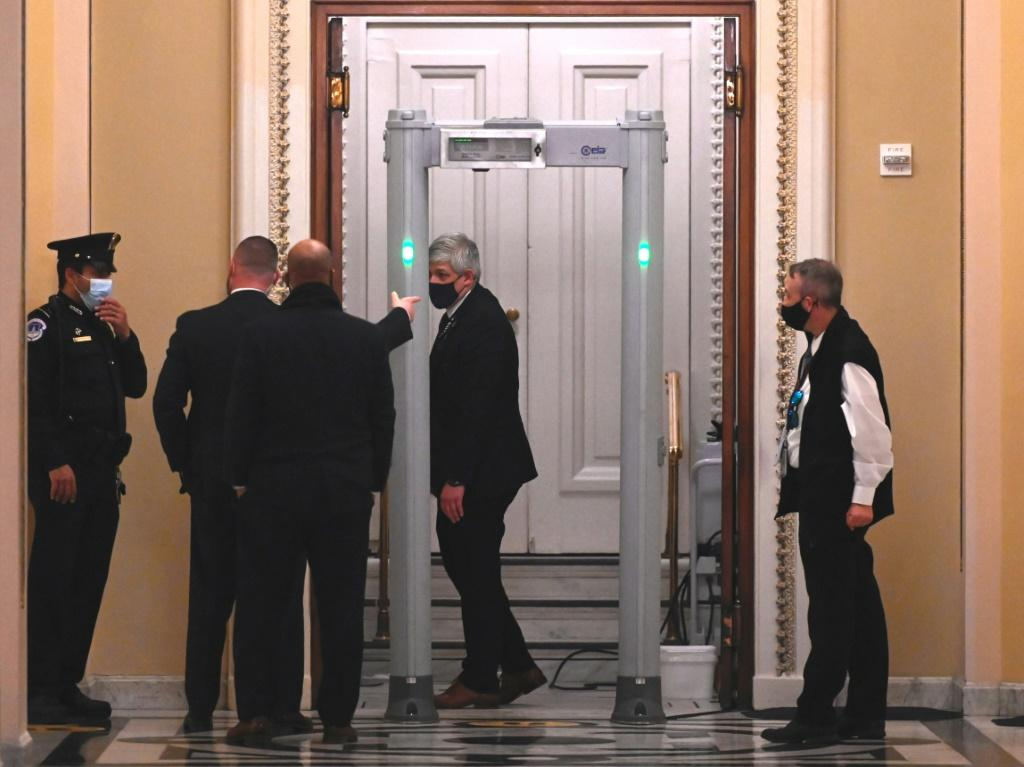 US Capitol Police stand near a metal detector outside chamber of the House of Representatives