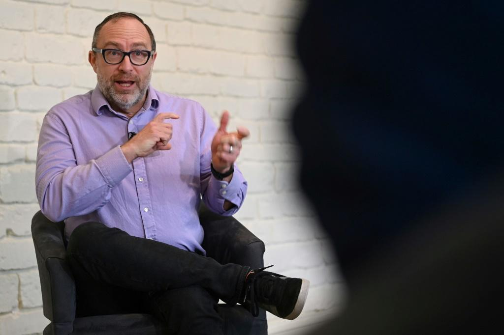 Wikipedia founder Jimmy Wales ackowledges he was afraid someone would beat him to creating a free online collaborative encyclopedia