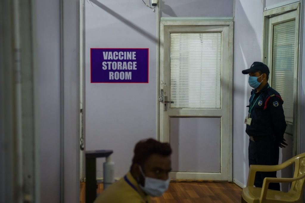 Security stands guard outside a Covid-19 vaccine storage room at a centre in Mumbai on January 15, 2021