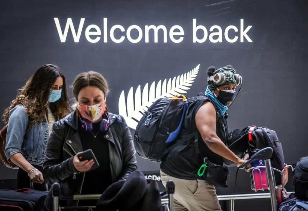 Passengers arrive at Sydney airport. Australia's border has been largely closed to overseas visitors since March 2020
