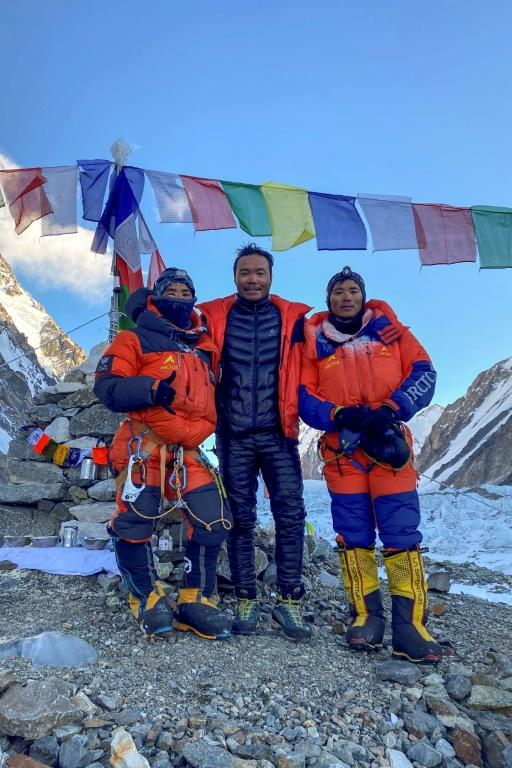 This photo taken on January 16, 2021 by Seven Summit Treks shows Nepali mountaineers Sona Sherpa (R), Galje Sherpa (L) and Chhang Dawa Sherpa after reaching the summit of K2, in the Gilgit-Baltistan region of Pakistan