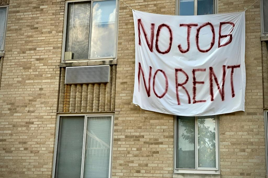 A banner protests eviction on a building in Washington