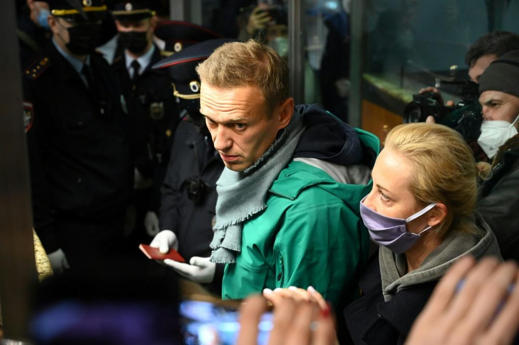 Russian opposition leader Alexei Navalny was carried away by police on arrival in Moscow, sparking a wave of Western condemnation