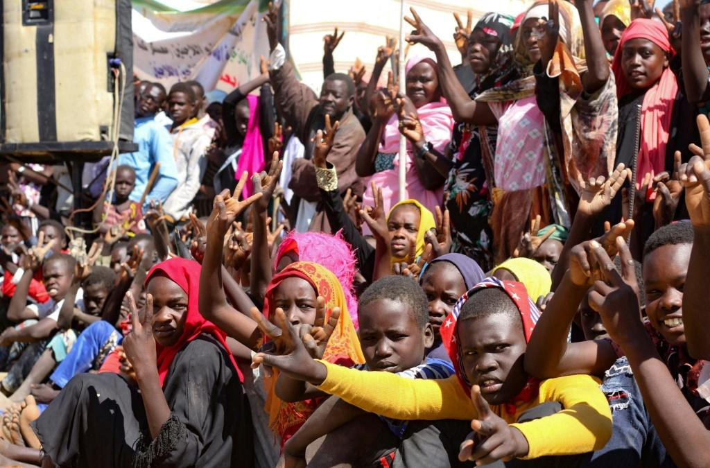 A December 31 file picture shows Sudanese internally displaced people in South Darfur protesting against the end of the United Nations and African Union peacekeeping mission