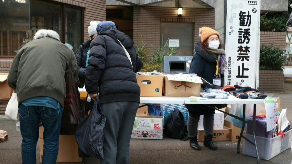 Food parcels are distributed by charity groups in Tokyo to help the the growing number of Japanese pushed into poverty by the coronavirus pandemic