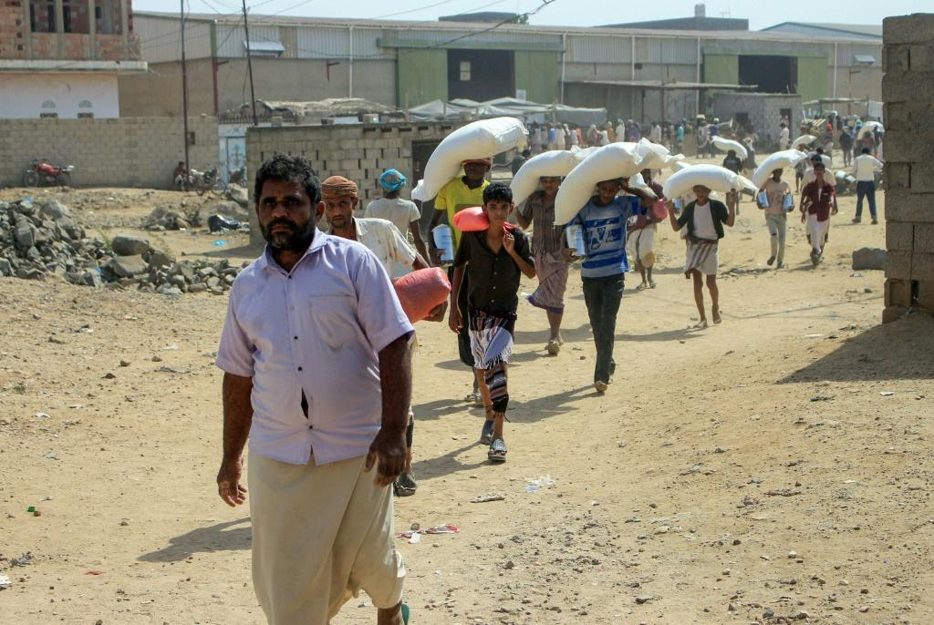 Displaced Yemenis receive humanitarian aid provided by the World Food Programme (WFP) in the northern province of Hajjah