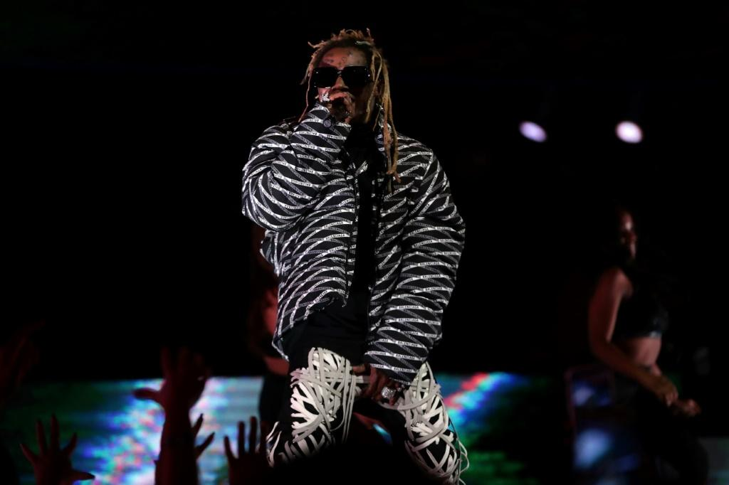 """Rapper Lil Wayne was pardoned for exhibiting """"generosity through commitment to a variety of charities, including donations to research hospitals and a host of foodbanks"""