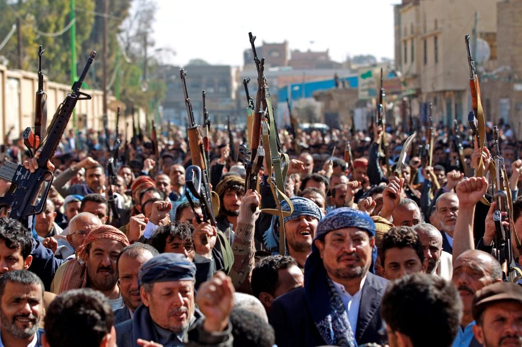 Supporters of Yemen's Huthi movement chant slogans during a demonstration against the outgoing US administration's decision to designate the Iran-backed rebels as terrorists, in the capital Sanaa