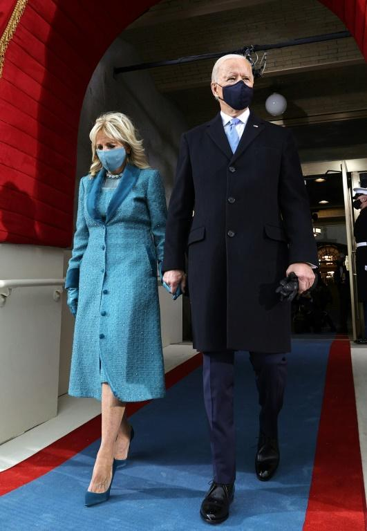 US President-elect Joe Biden (R) and incoming US First Lady Jill Biden arrive for his inauguration as the 46th US President, on the West Front of the US Capitol in Washington, DC on January 20, 2021