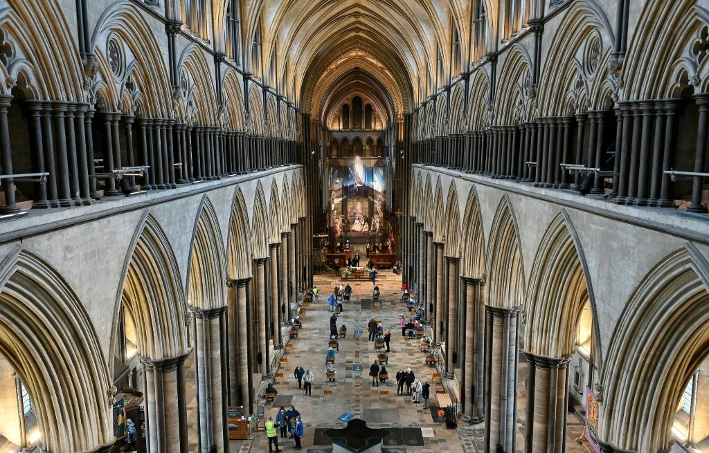 A temporary vaccination centre has been set up inside Salisbury Cathedral in southwest England, with musicians playing the 19th-century organ to soothe the nerves of those waiting for their shots